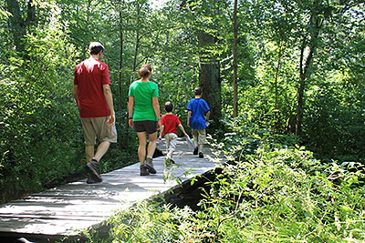 A Family Walking in Fort Barton Woods